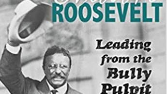 Theodore Roosevelt raising his hat while campaigning