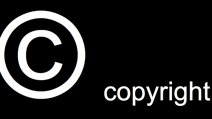 white copyright symbol and text on black background