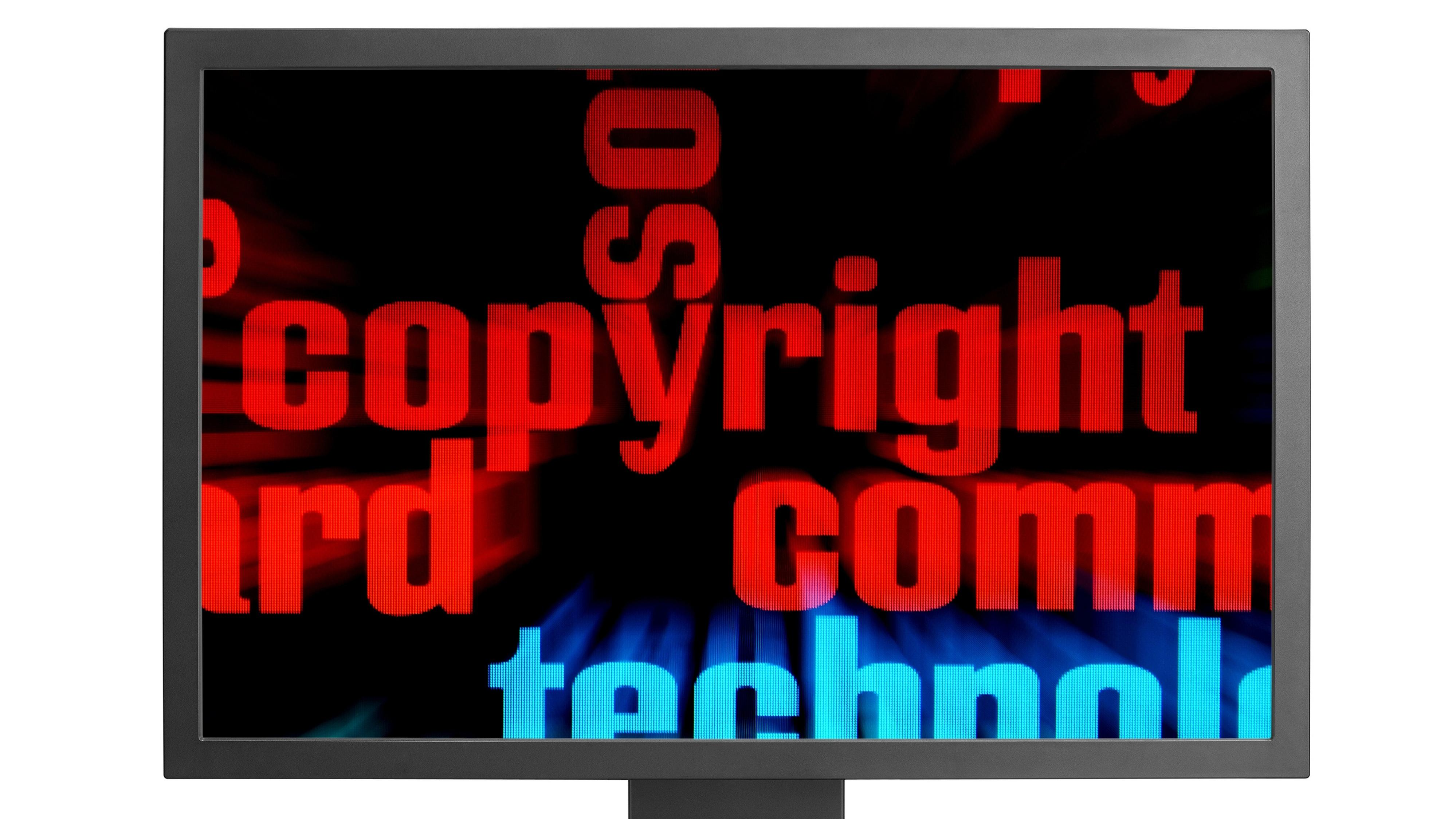 Red lettering reading copyright on a black computer screen