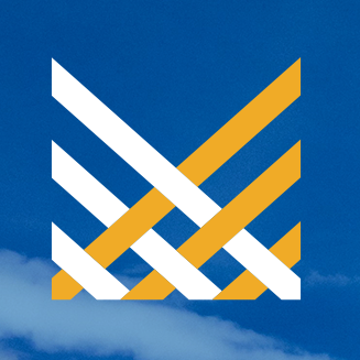 "The Minitex 50th anniversary logo, ""Minitex, Celebrating 50 Years,"" set in front of a blue sky."